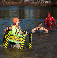 """There was nothing """"slow"""" about Miriam Simmons/Meredith Village Savings Bank as she came out of Lake Opechee after her swim during the 7th annual Salvation Army Turkey Plunge Saturday afternoon.   (Karen Bobotas/for the Laconia Daily Sun)"""