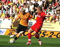 Photo: Paul Greenwood. <br />Wolverhampton Wanderers v Watford. Coca Cola Championship. 11/08/2007. <br />Wolves Andy Keogh (L) takes on Jay Demeritt