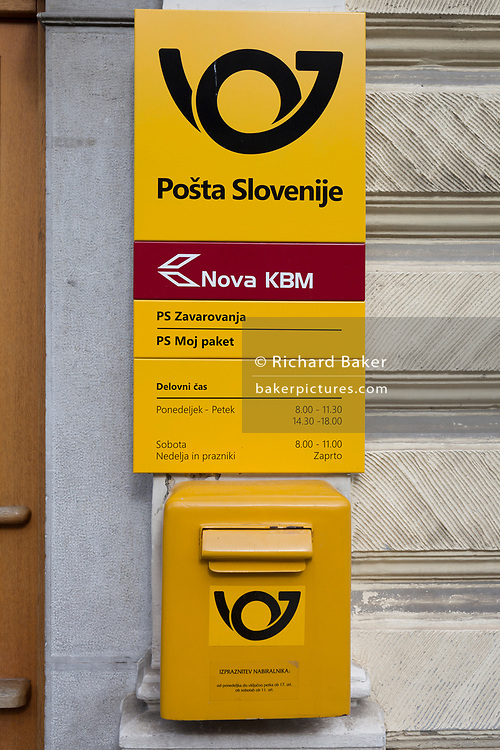 A post box from the Slovenian postal service (Posta Slovenije outside the post office in rural Slovenia, on 26th June 2018, in Kamnik, Slovenia.