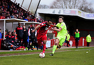 Crawley Town Defender Lanre Oyebanjo (2) beats Hartlepool United midfielder Lewis Hawkins (18) during the Sky Bet League 2 match between Crawley Town and Hartlepool United at the Checkatrade.com Stadium, Crawley, England on 19 March 2016. Photo by Jon Bromley.