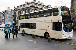 Pictured: <br /> <br /> Lothian Buses launches its 'Poppy Bus'. The vehicle, which is white with quotes from well-known war poems painted on it, will run on various routes throughout November. Ex-Forces staff and Poppy Scotland head of fundraising Gordon Michie were there to give it a good send off<br /> <br /> Ger Harley | EEm 27 October 2016
