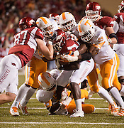 Nov 12, 2011; Fayetteville, AR, USA;  Arkansas Razorbacks running back Broderick Green (29) is brought down by Tennessee Volunteers defensive linemen Jacques Smith (55) and other devenders during a game at Donald W. Reynolds Razorback Stadium. Arkansas defeated Tennessee 49-7. Mandatory Credit: Beth Hall-US PRESSWIRE