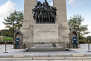 Two guards at the National War Memorial in Ottawa, Ontario, Canada. The 21.34 m (70 ft) granite memorial arch and bronze sculptures was built in 1939 to commemorate the soldiers dying in the First World War but now represents all Canadians killed in any conflicts in the past or future.