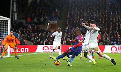 Crystal Palace's Wilfried Zaha (centre) in action during the Premier League match at Selhurst Park, London.