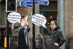 © Licensed to London News Pictures . 12/11/2016 . Manchester , UK . Protesters wearing Theresa May and Sajid Javid masks . Approximately 2000 people march and rally against Fracking in Manchester City Centre . Photo credit : Joel Goodman/LNP