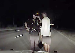 June 1, 2017 - Jupiter, Etats-Unis - Police have released 98 minutes of footage of Tiger Woods as he underwent tests and was arrested after being found asleep at the wheel of his running car in the wee hours MondayTiger could barely stand up and kept weaving and bobbing, failing to walk a straight line barefoot after removing his sneakersJupiter Police Department, in Florida, also released photos of the sportsman's damaged $220,000 USD Mercedes AMG.Both tire rims on the driver's side of the Mercedes had some small but visible damage, while the front and rear tires on that side were flatThere was also some minor damage to the bumper on the driver's side, and scuffs and scratches on the rear bumperThe 41-year-old golfer had to be woken up by an officer and stated that he did not know where he was after first claiming he had driven from California His speech was 'extremely slow and slurred' according to the report, and he failed four field sobriety testsWoods did submit to a breathalyzer and blew a .000 both times, which suggests that there was no alcohol in his system but he was on prescription drugsIn more than an hour and a half of video, Tiger is seen swaying, rolling his eyes and falling asleep as police administer field sobriety tests before he was arrested for DUI and taken into police custody.Slurring his words as he tried to answer questions from police, Tiger could barely stand up and kept weaving and bobbing, failing to walk a straight line barefoot after removing his sneakers. # ARRESTATION DE TIGER WOODS (Credit Image: © Visual via ZUMA Press)