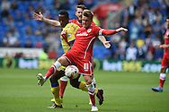 Craig Noone of Cardiff city (11) holds off Sheff Wed's Liam Palmer. Skybet football league championship match, Cardiff city v Sheffield Wed at the Cardiff city stadium in Cardiff, South Wales on Saturday 27th Sept 2014<br /> pic by Andrew Orchard, Andrew Orchard sports photography.