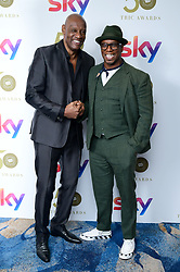 Shaun Wallace and Ian Wright attending the TRIC Awards 2019 50th Birthday Celebration held at the Grosvenor House Hotel, London.