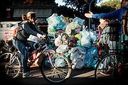 Cassonetti stracolmi di rifiuti per le strade della capitale. Roma, 1 maggio 2014. Christian Mantuano / OneShot