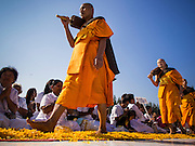 "02 JANUARY 2015 - KHLONG LUANG, PATHUM THANI, THAILAND: Monks leave the meditation hall at Wat Phra Dhammakaya to start the 4th annual Dhammachai Dhutanaga (a dhutanga is a ""wandering"" and translated as pilgrimage). More than 1,100 monks are participating in a 450 kilometer (280 miles) long pilgrimage, which is going through six provinces in central Thailand. The purpose of the pilgrimage is to pay homage to the Buddha, preserve Buddhist culture, welcome the new year, and ""develop virtuous Buddhist youth leaders."" Wat Phra Dhammakaya is the largest Buddhist temple in Thailand and the center of the Dhammakaya movement, a Buddhist sect founded in the 1970s.   PHOTO BY JACK KURTZ"