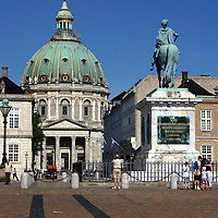 Europe, Denmark, Copenhagen. Frederik's Church and statue of Frederik V in Amalienborg Square.