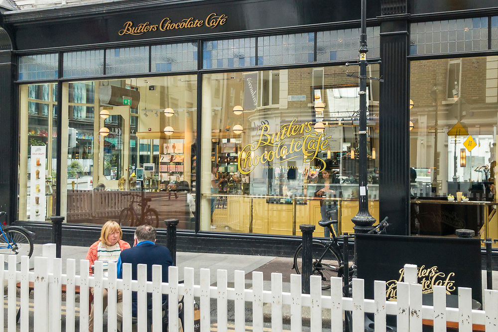 White picket fences surround the newly designated outdoor eating areas which were formally parking places, due to the Covid-19 pandemic, outside Butlers Chocolate Cafe, on Duke Street, in Dublin 2