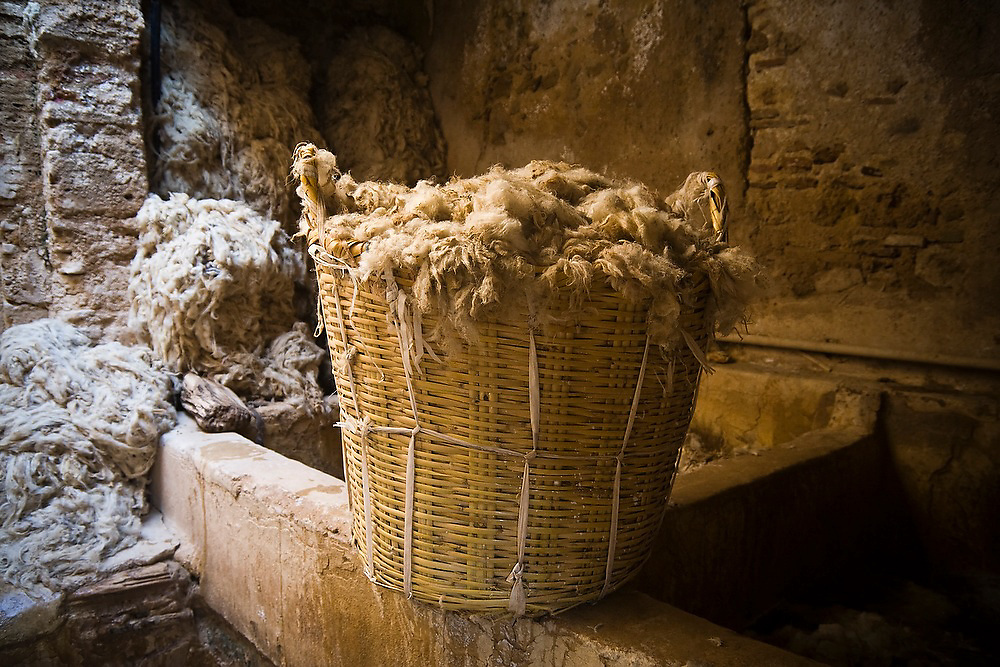 A basket of sheep's wool in at the Berber leather tannery in Fes El-Bali, Morocco.