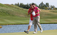 Caddie John Rawlings with Jaco Van Zyl (RSA) completing their Final Round to finish in 3rd place, at the 2015 Alstom Open de France, played at Le Golf National, Saint-Quentin-En-Yvelines, Paris, France. /05/07/2015/. Picture: Golffile | David Lloyd<br /> <br /> All photos usage must carry mandatory copyright credit (© Golffile | David Lloyd)