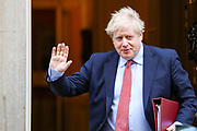 Britain's Prime Minister Boris Johnson waves to the media as he leaves 10 Downing Street for the House of Commons for his weekly Prime Ministers Questions, Wednesday, March 25, 2020. British lawmakers will vote later Wednesday to shut down Parliament for 4 weeks, due to the coronavirus outbreak. (Photo/Vudi Xhymshiti)