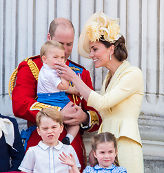 English Royals on the balcony during Trooping the Colour ceremony, marking the monarch's official birthday, in London. 08 Jun 2019 Pictured: Camilla Duchess of Cornwall, Catherine Duchess of Cambridge, Kate Middleton, Prince Harry Duke of Sussex, Meghan Markle Duchess of Sussex, Princess Beatrice of York, Princess Eugenie of York and husband Jack Brooksbank, Prince Charles of Wales, Prince William Duke of Cambridge, Queen Elizabeth II. Photo credit: MEGA TheMegaAgency.com +1 888 505 6342