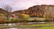 A Panoramic View Of Pasture Lands, A Small River And The Mountains Of Central New York State On A Rainy And Overcast Evening During The Peak Of Autumn, USA