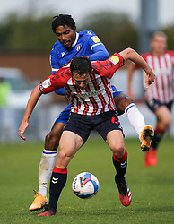 Ben Garrity of Oldham Athletic and Jevani Brown of Colchester United tussle for the ball - Mandatory by-line: Arron Gent/JMP - 03/10/2020 - FOOTBALL - JobServe Community Stadium - Colchester, England - Colchester United v Oldham Athletic - Sky Bet League Two