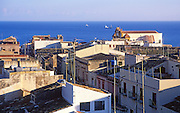 View to the sea over rooftops and streets in Castellammare del Golfo, Sicily, Italy