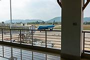 A Vietnam Airlines jet aircraft approaches the jet bridge at the Luang Prabang Airport,  Luang Prabang, Laos.