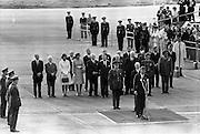President John F. Kennedy arrives at Dublin Airport.  Kennedy replies to President de Valera's speech of welcome.  Onlookers include President Kennedy's sisters, Mrs. Eunice Shriver and Mrs. Jean Smith; An Taoiseach Seán Lemass; An Tanaiste Mr. Sean McAntee; Dr. James Ryan, Minister for Finance, and Mr. Frank Aiken, Minister for External Affairs..26.06.1963