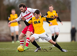 Stirling Albion's Mark Lamont and East Fife's Kyle Wilkie. <br /> Half time : East Fife 0 v 0 Stirling Albion, Scottish Football League Division Two game played atBayview Stadium, 20/2/2106.