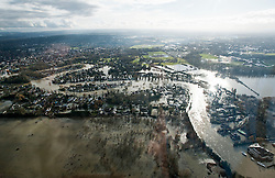 © London News Pictures.  09/02/2014. Shepperton, UK. Recent flood waters have subsided in the Shepperton area. Picture shows  Aerial view showing flooding covering Shepperton, Surrey around the hieight of the water level last week. . Photo credit : Ben Cawthra/LNP
