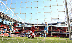 Arsenal's Pierre-Emerick Aubameyang scores his side's first goal of the game during the Premier League match at the Emirates Stadium, London.