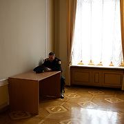 KIEV, UKRAINE - February 22, 2014: A policeman guards a room at the Ukrainian parliament building in Kiev. CREDIT: Paulo Nunes dos Santos