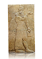 Chaldean Assyrian relief sculpture slab from the northwest palace of King Ashurnasirpal II of a Genie standing. 881-859 B.C form Nimrud or Nimrut ( Kalhu or Kalah). Istanbul Archaeological exhibit Inv. No. 5..<br /> <br /> If you prefer to buy from our ALAMY PHOTO LIBRARY  Collection visit : https://www.alamy.com/portfolio/paul-williams-funkystock/ancient-assyria-antiquities.html  Type -    Istanbul    - into the LOWER SEARCH WITHIN GALLERY box to refine search by adding background colour, place, museum etc<br /> <br /> Visit our ANCIENT WORLD PHOTO COLLECTIONS for more photos to download or buy as wall art prints https://funkystock.photoshelter.com/gallery-collection/Ancient-World-Art-Antiquities-Historic-Sites-Pictures-Images-of/C00006u26yqSkDOM