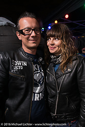 Sebastien Lorentz of Lucky Cats and Sultans of Sprint with his lovely girlfriend Lolo at the Booze Bon party at the Amadeus Speed Shop after a long day at the Intermot Motorcycle Trade Fair. Cologne, Germany. October 9, 2016. Photography ©2016 Michael Lichter.
