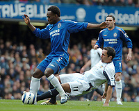 Photo: Ed Godden.<br />Chelsea v West Ham United. The Barclays Premiership. 09/04/2006. Michael Essien (L) is tackled from behind by West Ham's Matthew Etherington.