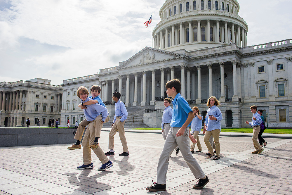 Washington, D.C. - October 07, 2016: En Route to their third and final meeting of the day, members of the Hyperbolics walk past the U.S. Capital Building. ...well, almost all of them walk.<br /> <br /> The Hyperbolics are a First Lego League team based out of Sterling School in Greenville SC, who made a trip to DC ask government officials to ban lead wheel weights Friday October 7, 2016.<br /> <br /> <br /> CREDIT: Matt Roth for Earthjustice