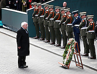President Michael D Higgins takes a moment to pay his respects during the  Wreath laying ceremony for the 100th Anniversary of the 1916 Easter Rising at the GPO on Dublin's O Connell St. Picture Credit Frank Mc Grath<br />27/3/16