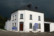 Belgium Road signs dark storm clouds in the sky