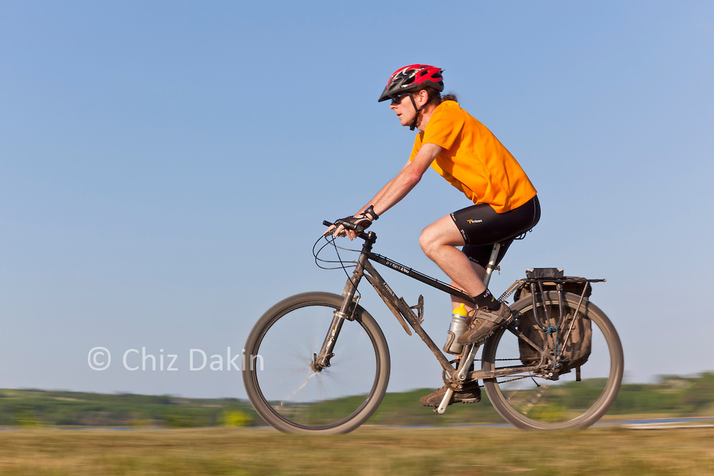 Cyclist on Carsington Water Dam Wall