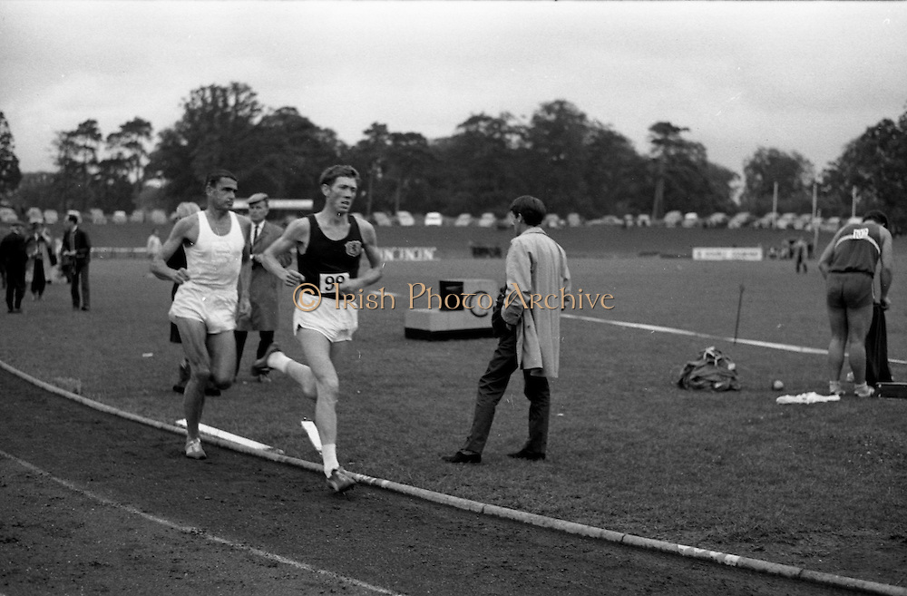 17/07/1967<br /> 07/17/1967<br /> 17 July 1967<br /> International Athletics at Santry Stadium, Dublin. Image shows Scotland's I. McCafferty and Australia's R. Clarke leading the field in the Men's Three Mile International race. On the right of the image is possibly M. Bryce of Scotland who competed in the Men's 16 lb. Hammer International competition.