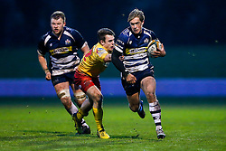 Bristol Rugby Winger Charlie Amesbury gets away from Scarlets XV replacement Shaun Pearce - Mandatory byline: Rogan Thomson/JMP - 17/01/2016 - RUGBY UNION - Clifton Rugby Club - Bristol, England - Scarlets Premiership Select XV v Bristol Rugby - B&I Cup.