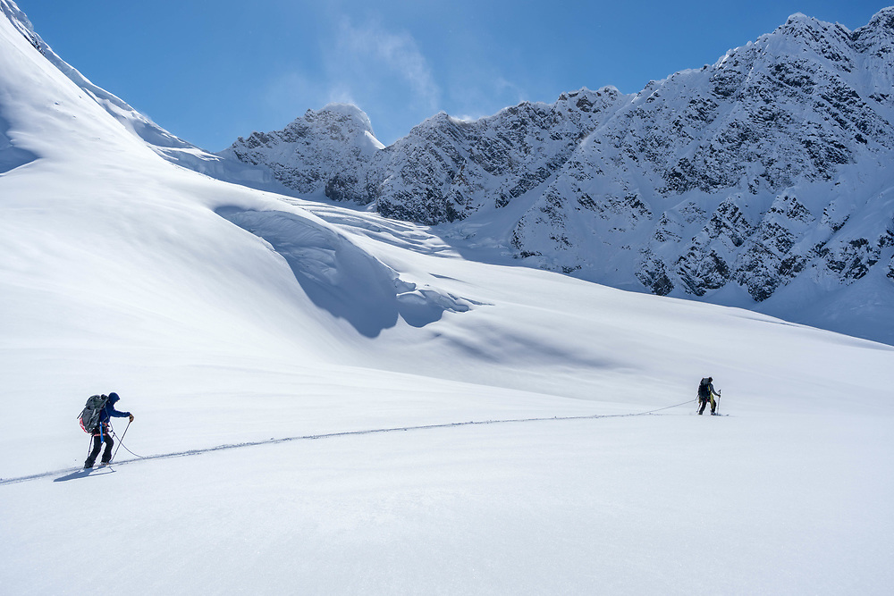 Two climbers make their way across the Ruth Glacier.