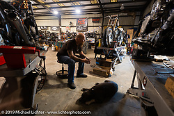 Bill Dodge with his dog Buddy in their Daytona Beach shop. FL, USA. Sunday, March 13, 2016. Photography ©2016 Michael Lichter.