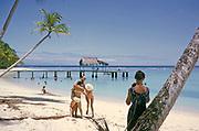 Tourists on sandy Buccoo beach Tobago, Trinidad and Tobago 1963 women playing around with man