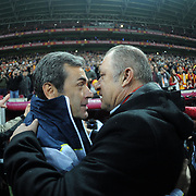 Galatasaray's coach Fatih Terim (R) and Fenerbahce's coach Aykut Kocaman (L) during their Turkish superleague soccer derby match Galatasaray between Fenerbahce at the TT Arena in Istanbul Turkey on Friday, 18 March 2011. Photo by TURKPIX
