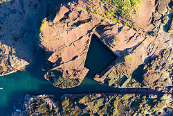 Aerial view of manmade harbour cut out of rock at Seacliff Beach in East Lothian, Scotland, UK