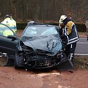 Ongeval met beknelling Crailoseweg Huizen, brandweer, ambulance, chaos, schade