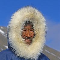 An Inuit hunter surveys the landscape near Pond Inlet on northern Baffin Island, Nunavut, Canada.