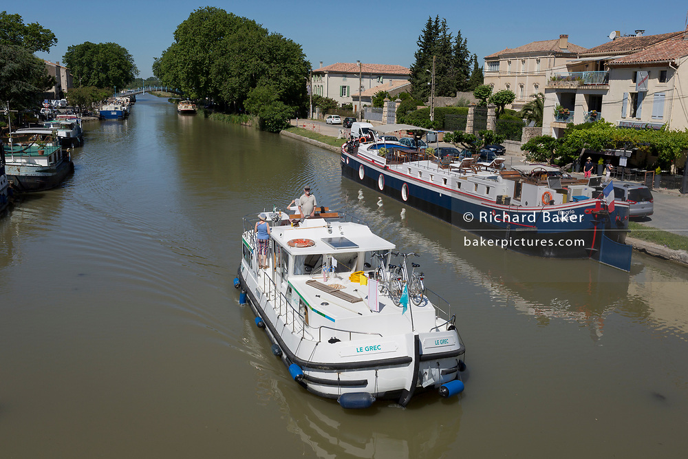 Aerial view of leisure boating including barges and cruisers on the Canal du Midi, on 25th May, 2017, in Homps, Languedoc-Rousillon, south of France