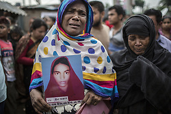April 24, 2017 - Savar, Dhaka, Bangladesh - A Bangladeshi relative of a victim of the Rana Plaza building collapse weeps as she marks the fourth anniversary of the disaster. Relatives of victims, and members of different garment organizations attended the commemoration ceremony in front of the Rana Plaza building site, where four years ago 1,135 workers died and about 2,500 were injured in the collapse, which highlighted the unsafe labor conditions for many of the four million workers in Bangladesh's garment industry. (Credit Image: © Probal Rashid via ZUMA Wire)