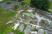 HANGZHOU, CHINA - JUNE 06: <br /> <br /> Aerial view of an open space piled up with colorful shared bicycles on June 6, 2017 in Hangzhou, Zhejiang Province of China. A total of about one thousand shared bicycles were transported to the open space by working staff of management committee for its adverse effect on environment and traffic safety. <br /> ©Exclusivepix Media