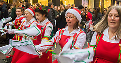 London, December 12th 2015. Tens of thousands of shoppers descend on London's west end as retailers keep prices low to encourage volume sales in the run-up to Christmas. PICTURED: The Dacre Morris Dancers, a women's team from Lewisham perform on Carnaby Street. ///FOR LICENCING CONTACT: paul@pauldaveycreative.co.uk TEL:+44 (0) 7966 016 296 or +44 (0) 20 8969 6875. ©2015 Paul R Davey. All rights reserved.