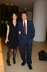 SIR PAUL McCARTNEY and his daughter MARY McCARTNEY at a Burns Night dinner in aid of CLIC Sargent and Children's Hospice Association Scotland held at St.Martin's Lane Hotel, St.Martin's Lane, London on 25th January 2007.<br />